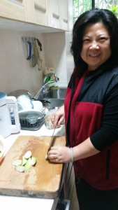 May carefully cuts garlic and ginger for our evening meal