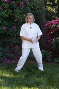 Margie Hare performing a Qi Gong warm up exercise