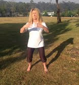 Sue Hetherington practicing Qigong in the park with Margie