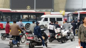 Chengdu daily traffic - Cars, busses, bicycles, scooters, three wheelers and taxi's all have right of way and pedestrians wait for a gap!